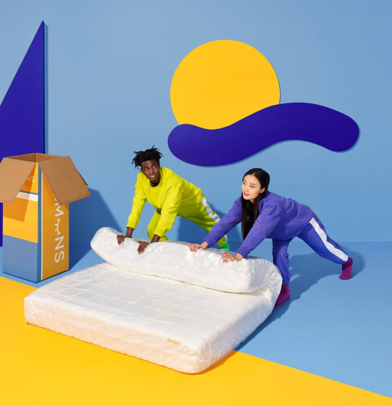 Man and Women unpacking Simmons Fun-zzz boxed mattress with ease.